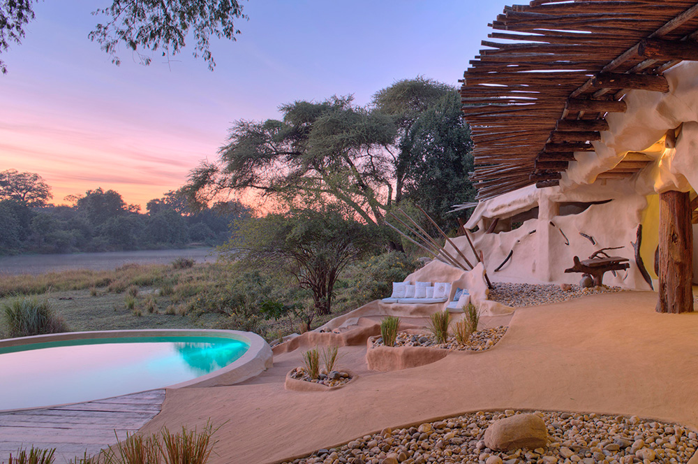 Chongwe Zambia - This stunning private house is set on a tranquil stretch of the Chongwe River against a beautiful mountainous backdrop